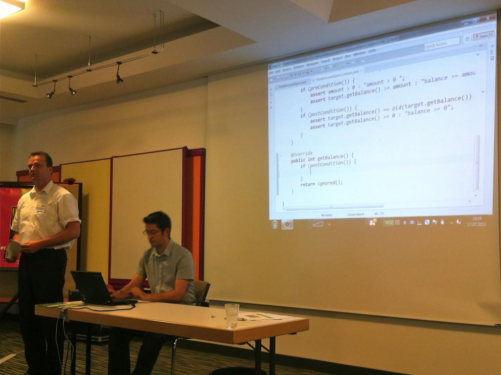 Hagen Buchwald explains Stefan Schürle's demonstration of Contracts for Java